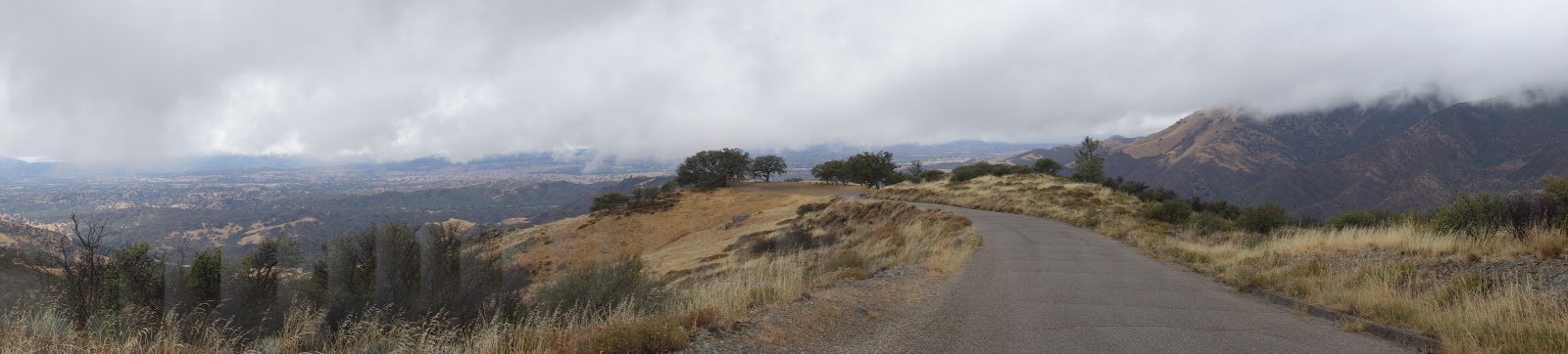Climbing Figueroa Road by bike - Los Padres National Forest sign and road.
