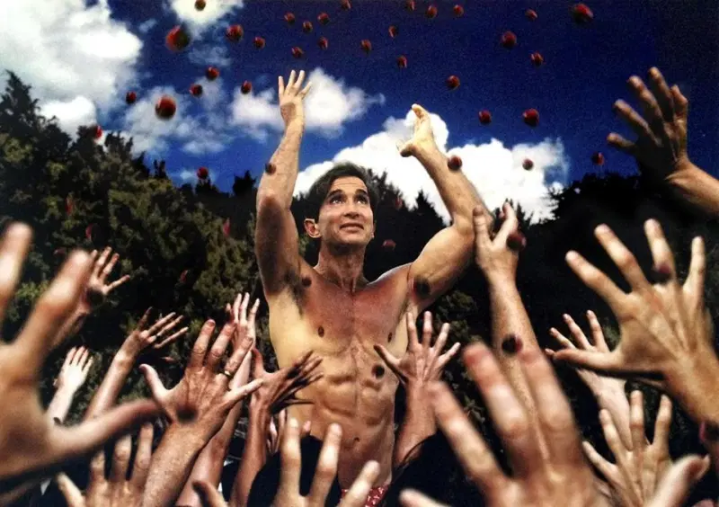 Topless man with his hands in the air