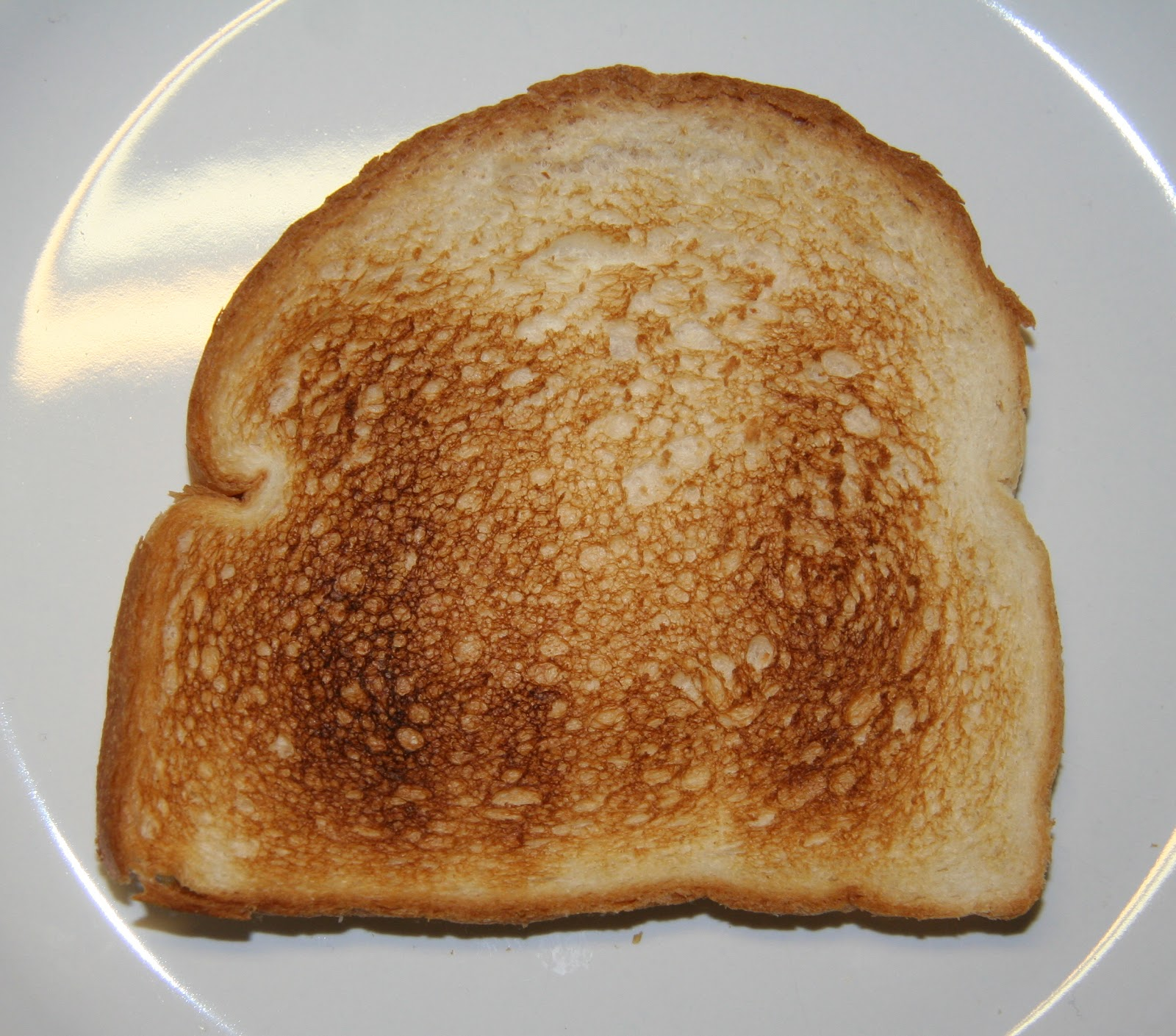 A plain dry slice of toast on