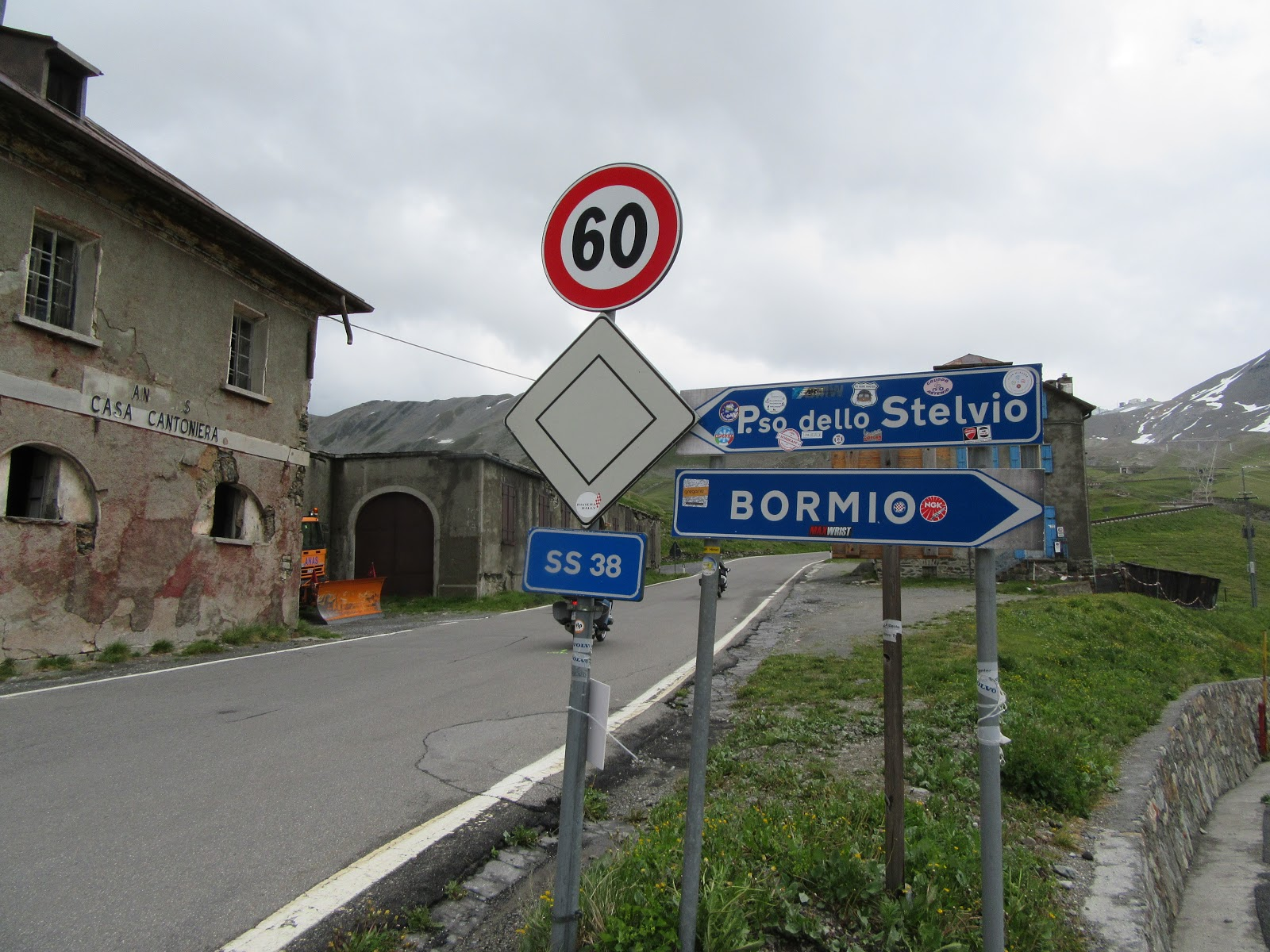 climbing Umbrail Pass by bike - sign to Passo Stelvio and Bormio, road, roadhouse