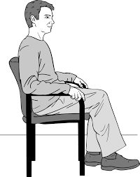 A person sitting in a chair  Description automatically generated
