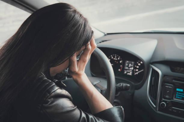 https://media.istockphoto.com/photos/stressed-woman-driver-sitting-inside-her-vehicle-brunette-girl-doing-picture-id1126440441?k=6&m=1126440441&s=612x612&w=0&h=ZiLaCVevalTypbnGQDSupVzDuKQOW153gDEASZjVKUs=