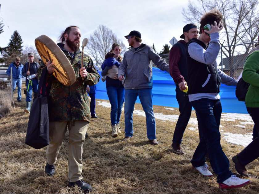 "Marchers unfurl a blue banner representing an underground creek during ""Rally in the Valley"" event in Calgary, Alta., on Saturday, March 18, 2017. The Save the Highland Valley Wetlands rally was in opposition to a high-rise development planned for the green space near 40 Ave. and 4 St. N.W. Bryan Passifiume/Postmedia Network"