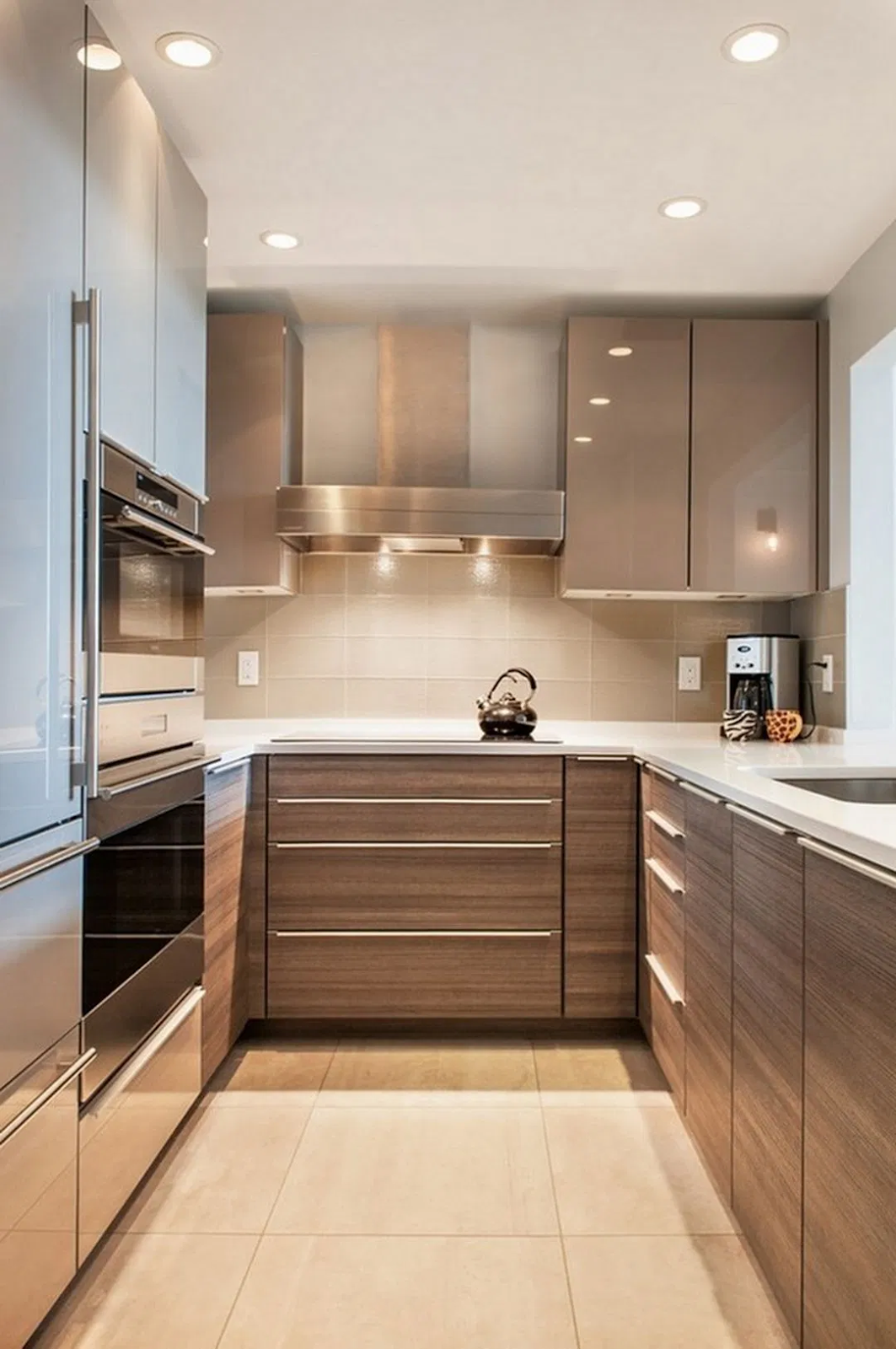 modern kitchen with beige high gloss cabinets, recessed lighting and minimalist decor