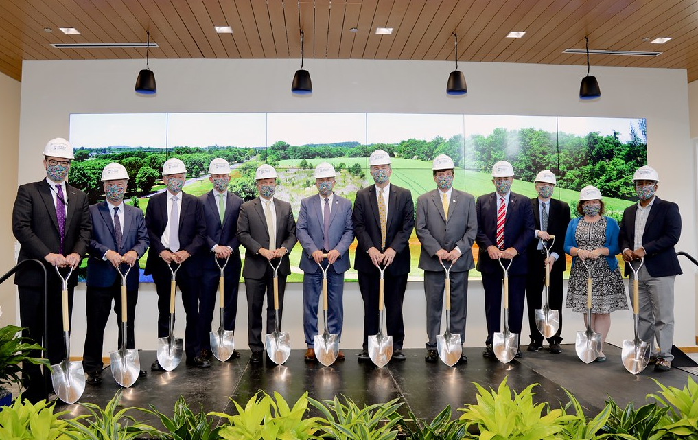 Hudson Alpha Ground Breaking Event. 12 people holding shovels with hard hats.
