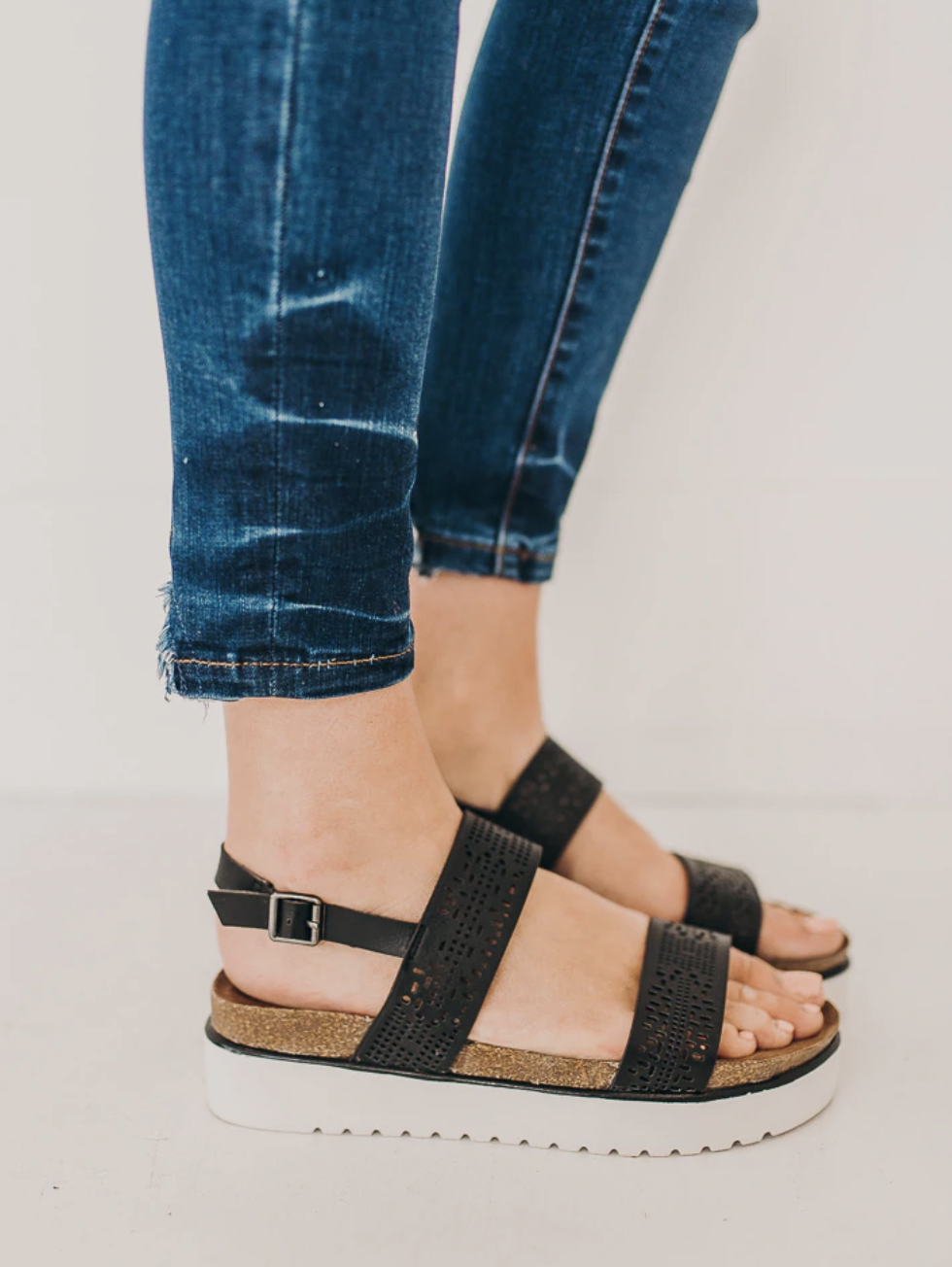 Open toed sandals with laser cut double band detail.