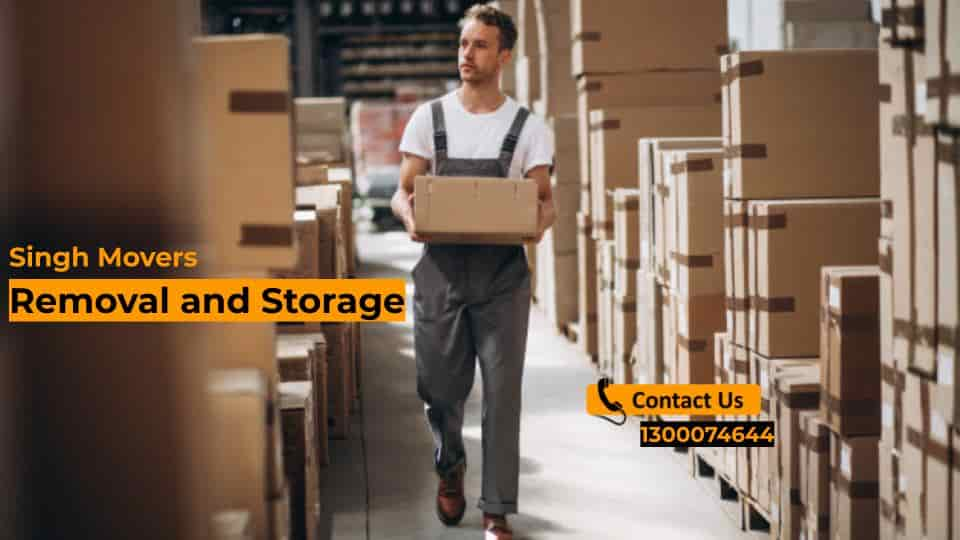Removal and Storage - Singh movers expert working at a storage house with boxes