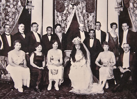 The bride's accessories highlight her Arab heritage in this Singapore wedding photo from the 1930's. A member of the Alsagoff family, she hailed from Makkah, where it is likely that her father was a trader.