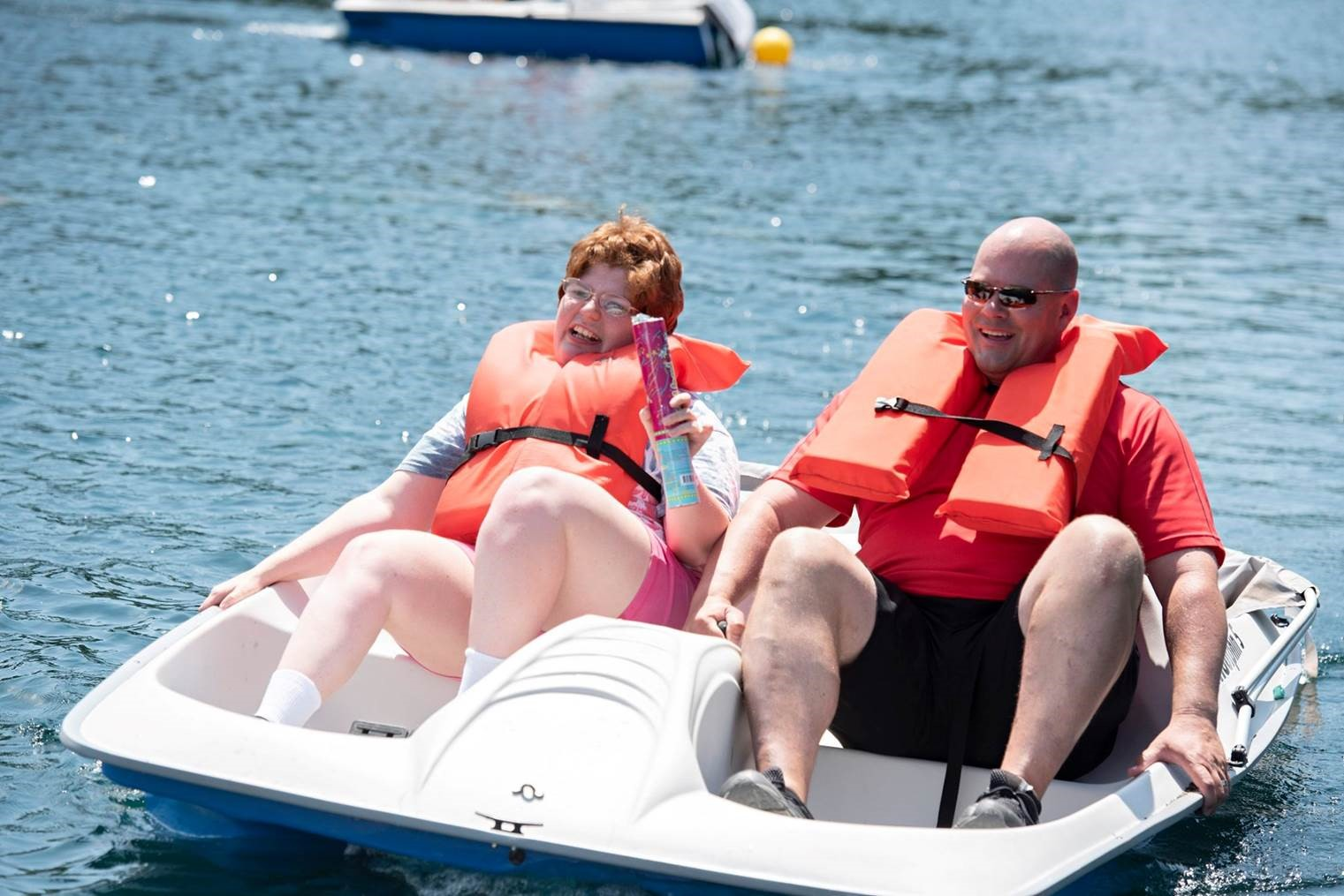 Image of a man and woman on a paddle boat.