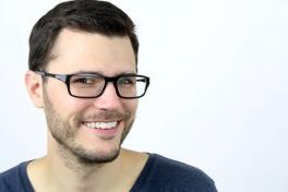 A person wearing glasses  Description automatically generated with low confidence