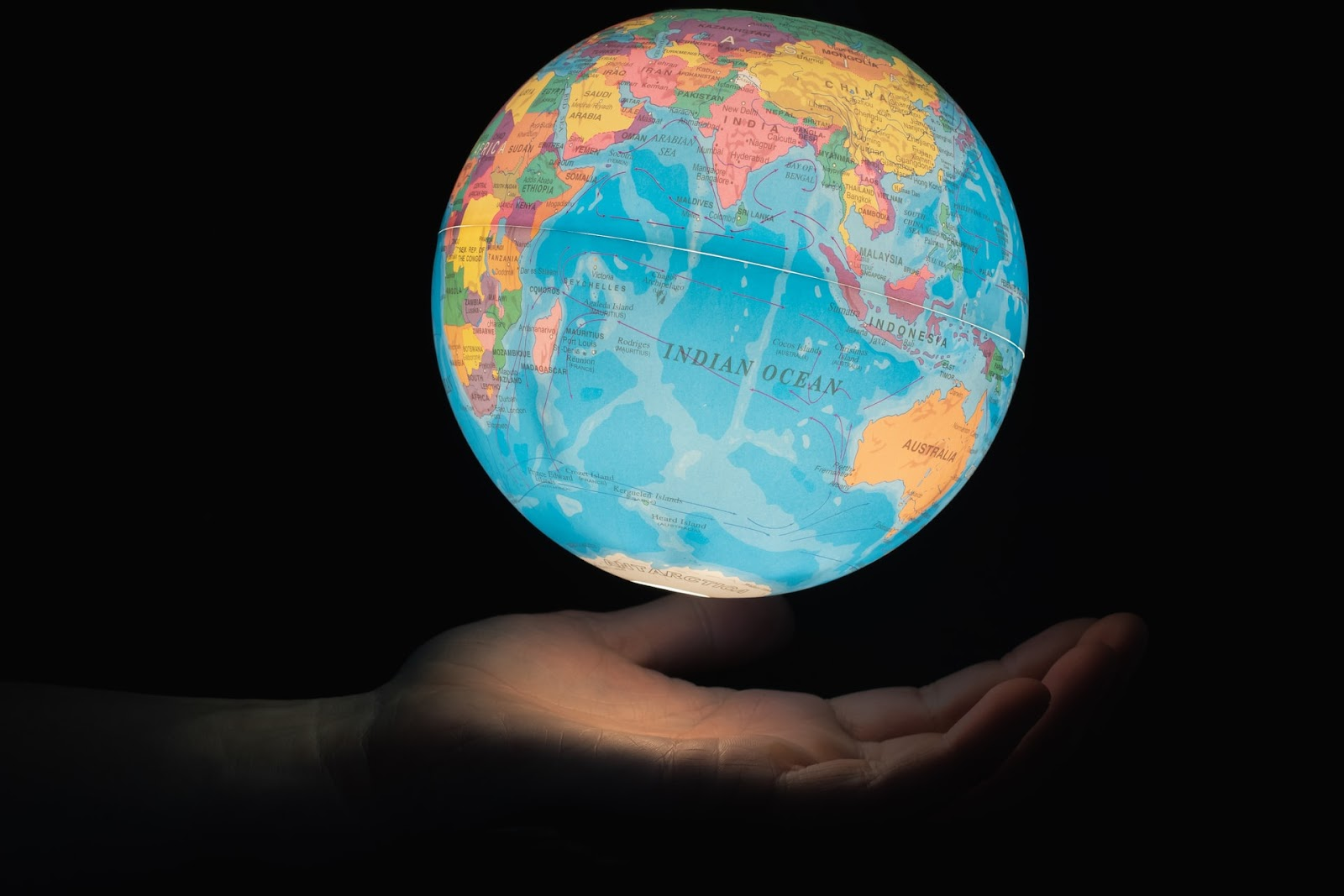 Hand holding an earth globe for Earth Day