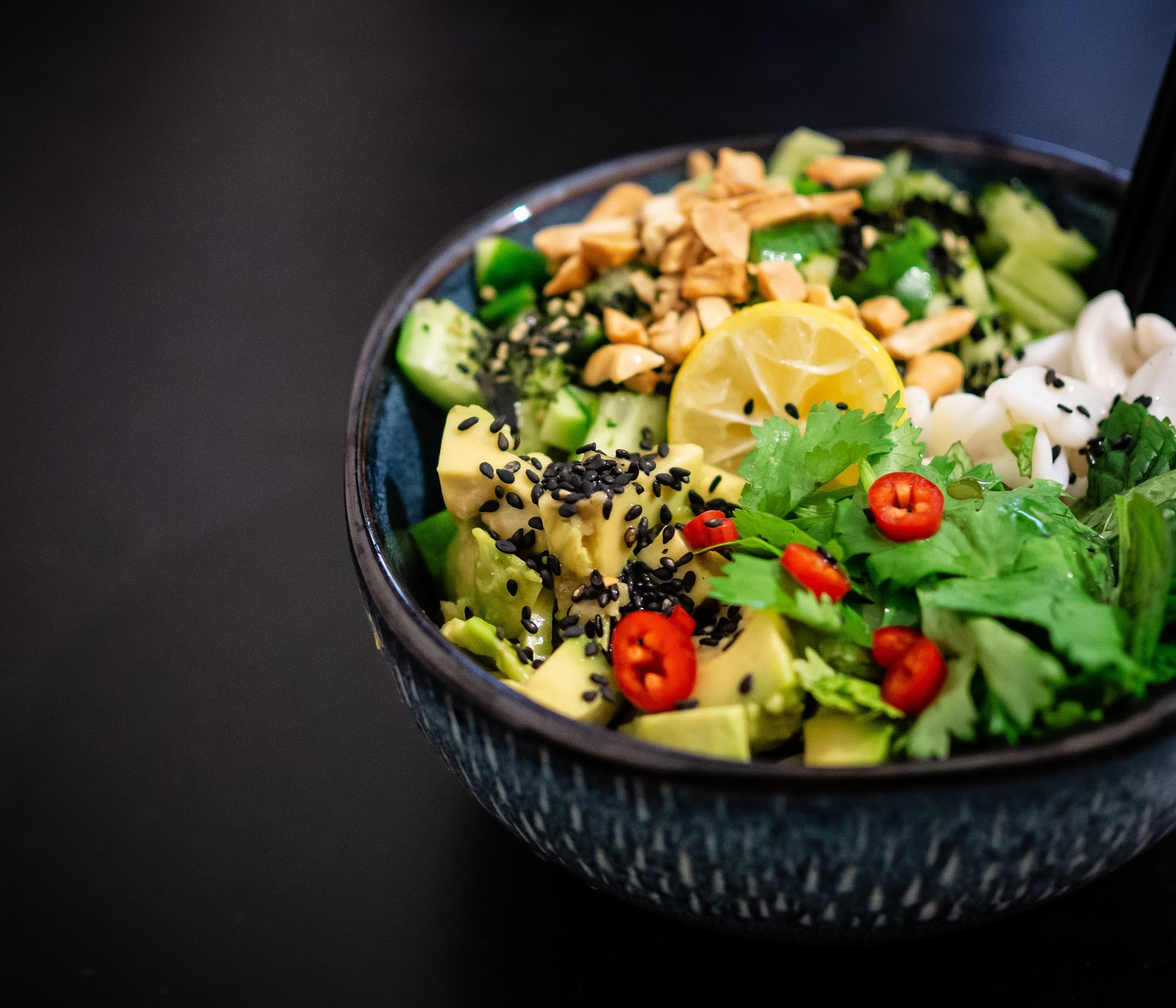 A delicious bowl of avocado, cashews and greens will satisfy your appetite for longer.