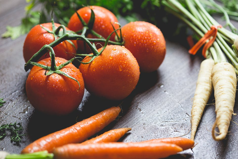 Tomatoes, Carrots And Radish On The Top Of The Table