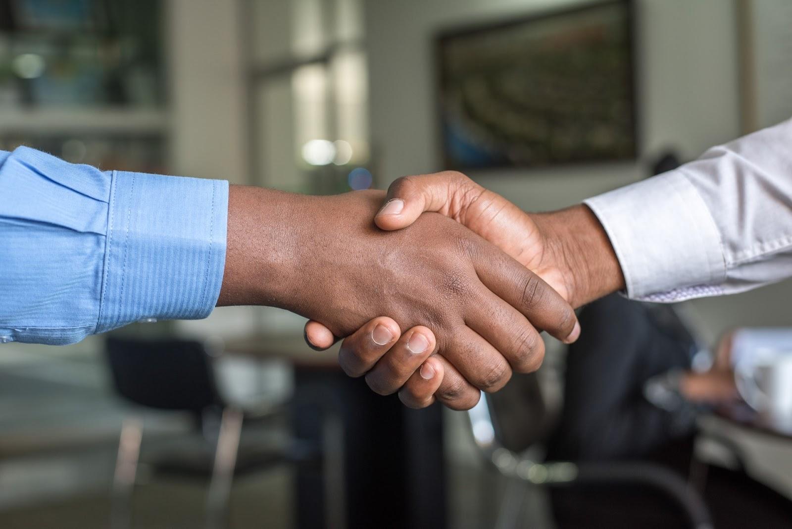Photo of handshake describing how you can become a posh ambassador for selling on poshmark