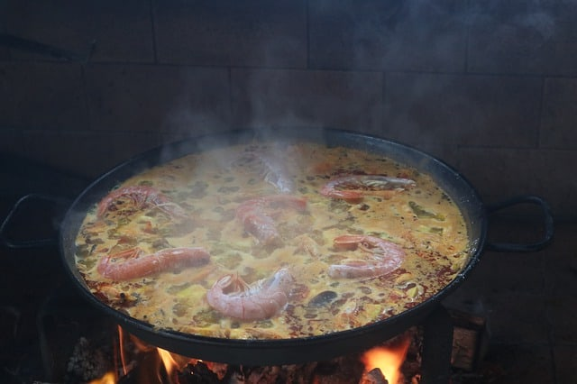 Spanish paella cooking in a pan in Barcelona