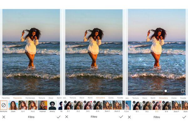 Mulher negra na praia, com os pés na água.