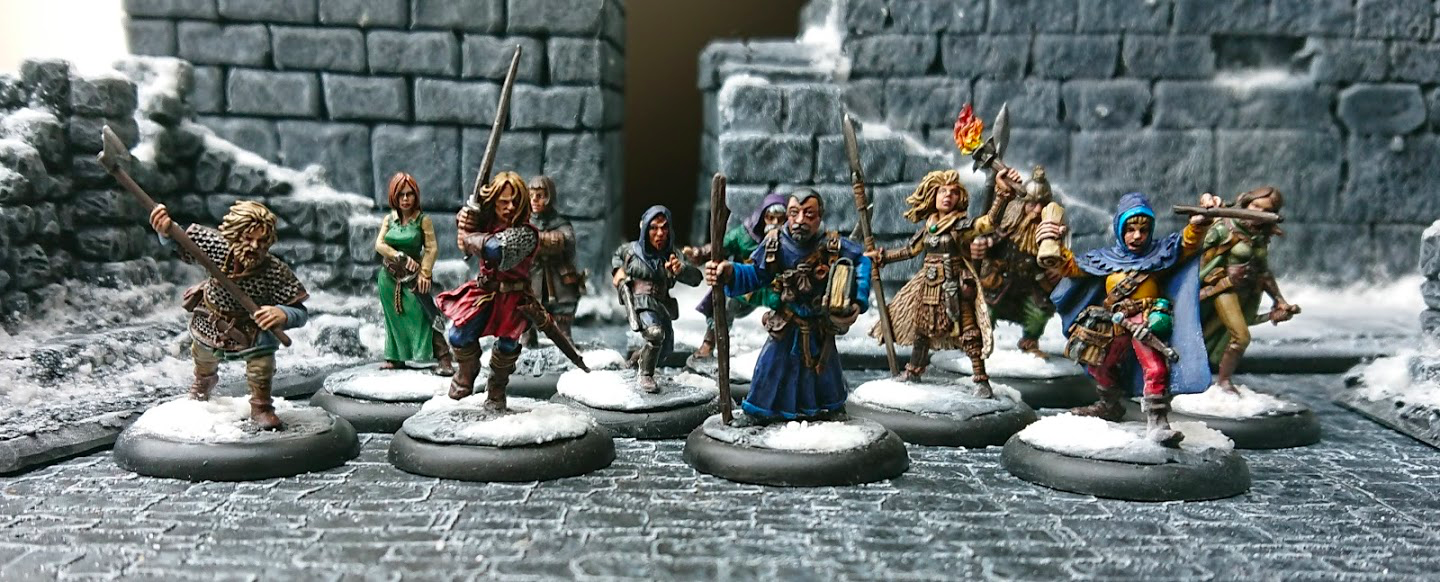 A warband of assorted fantasy heroes, including wizards, warriors, and rogues, presented against a snowy city.
