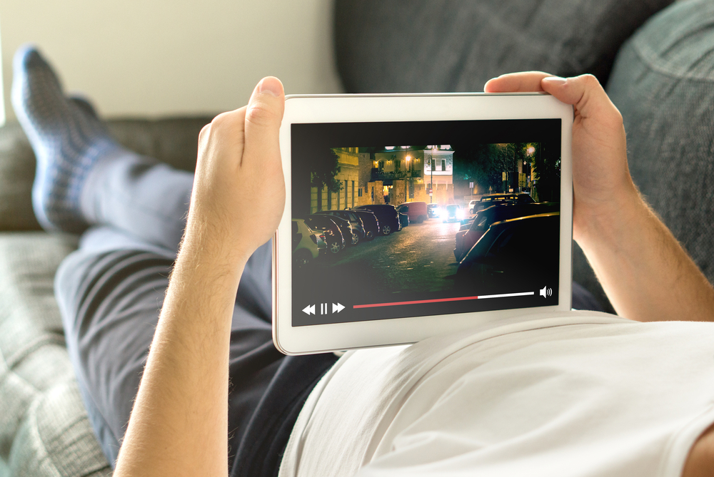 man watching movie on a tablet