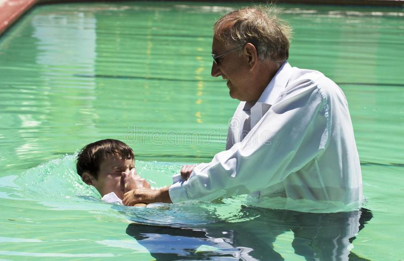 Evangelist Baptism submersion. Jesus modeled the process of baptism for us. Baptism symbolized dying to self and coming alive in Jesus. Many Christians including stock images