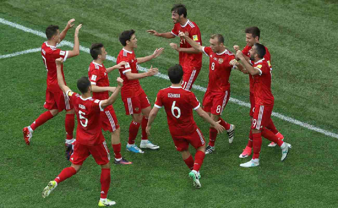 Alt: The Russian soccer team celebrates scoring a goal - Photo by Francois Nel/Getty Images