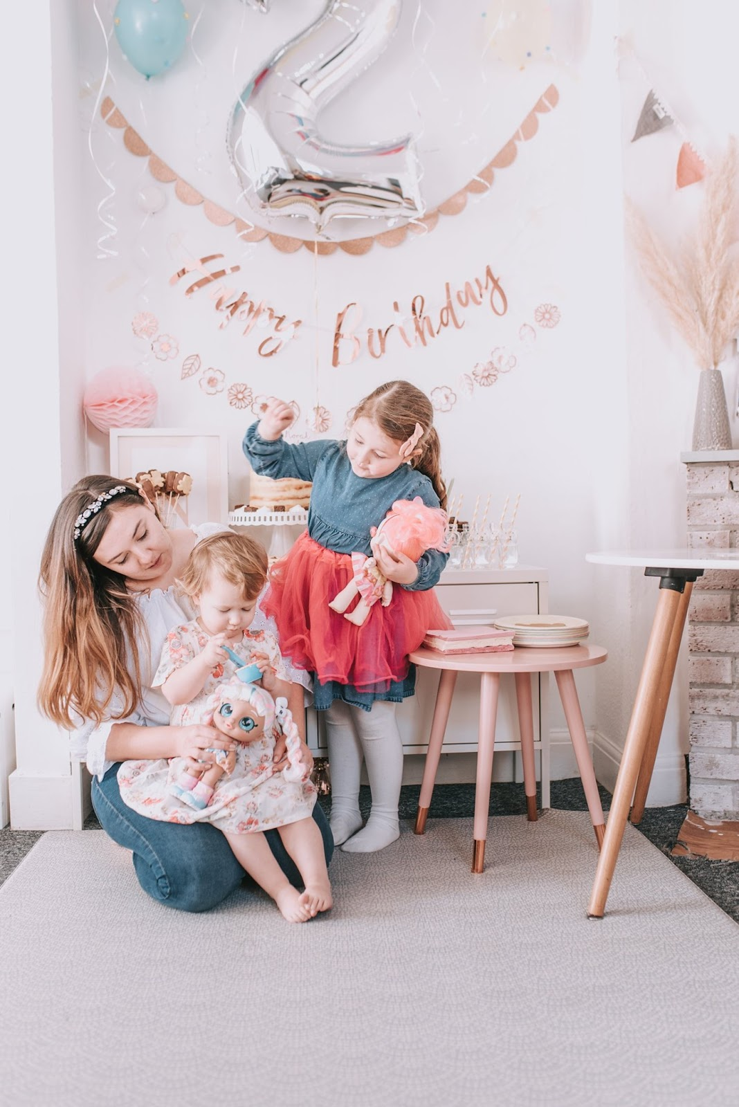 bear and rose gold themed birthday party family together