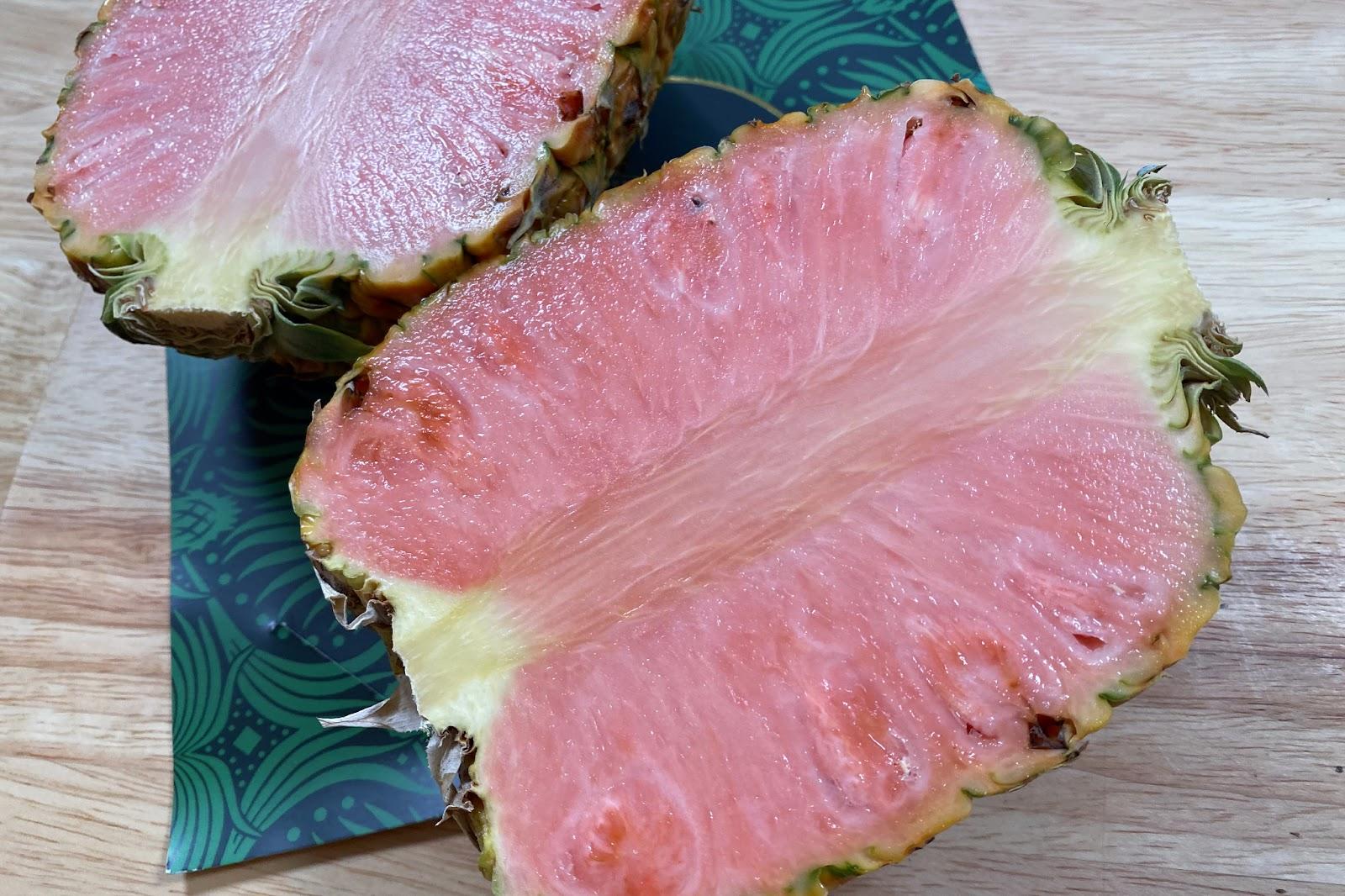 A Pinkglow pineapple cut in half.