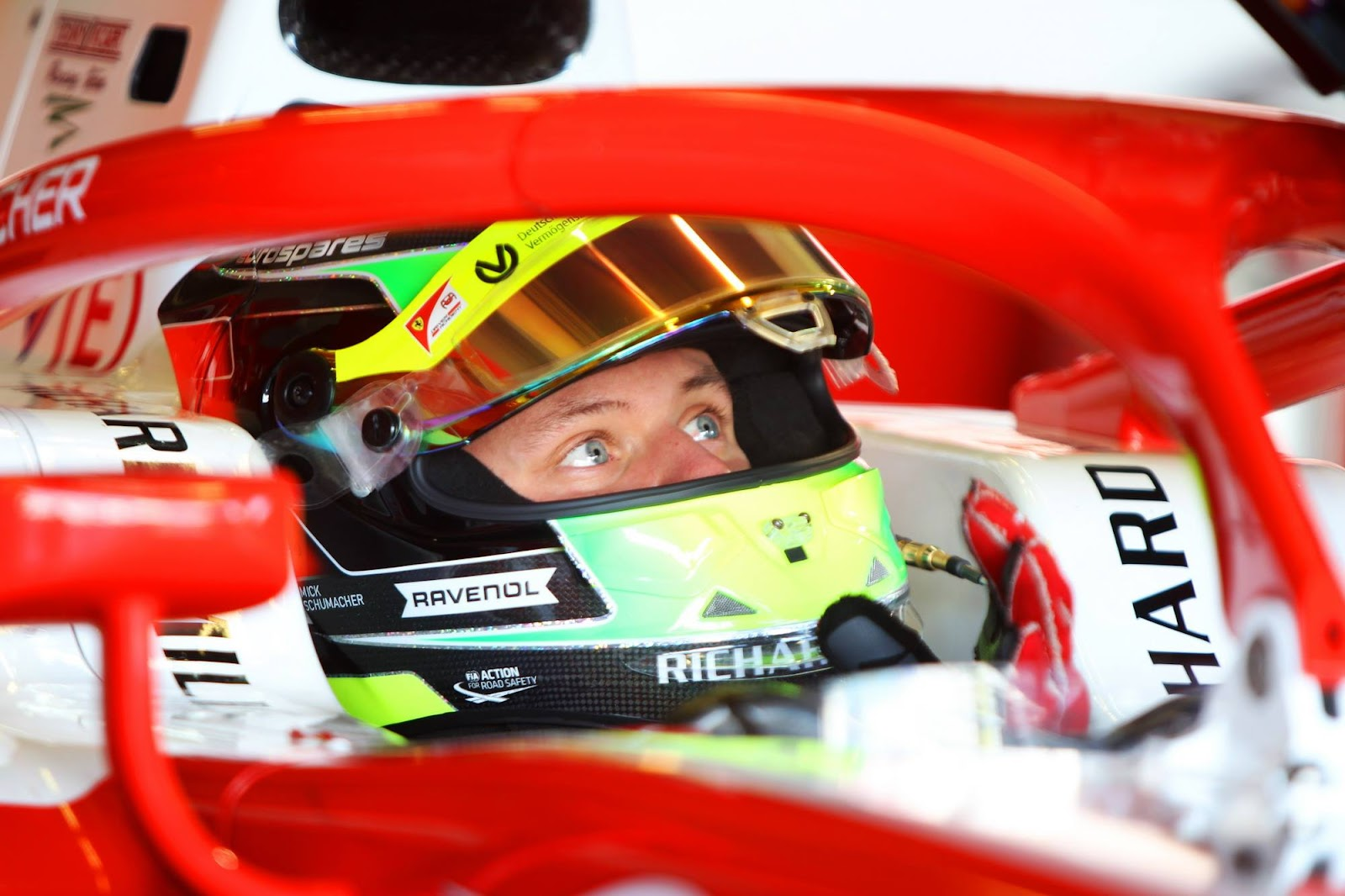 Mick Schumacher with halmet, Ravenol logo
