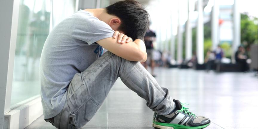 Echo-NHS-Sad-Boy-With-Head-In-Hands