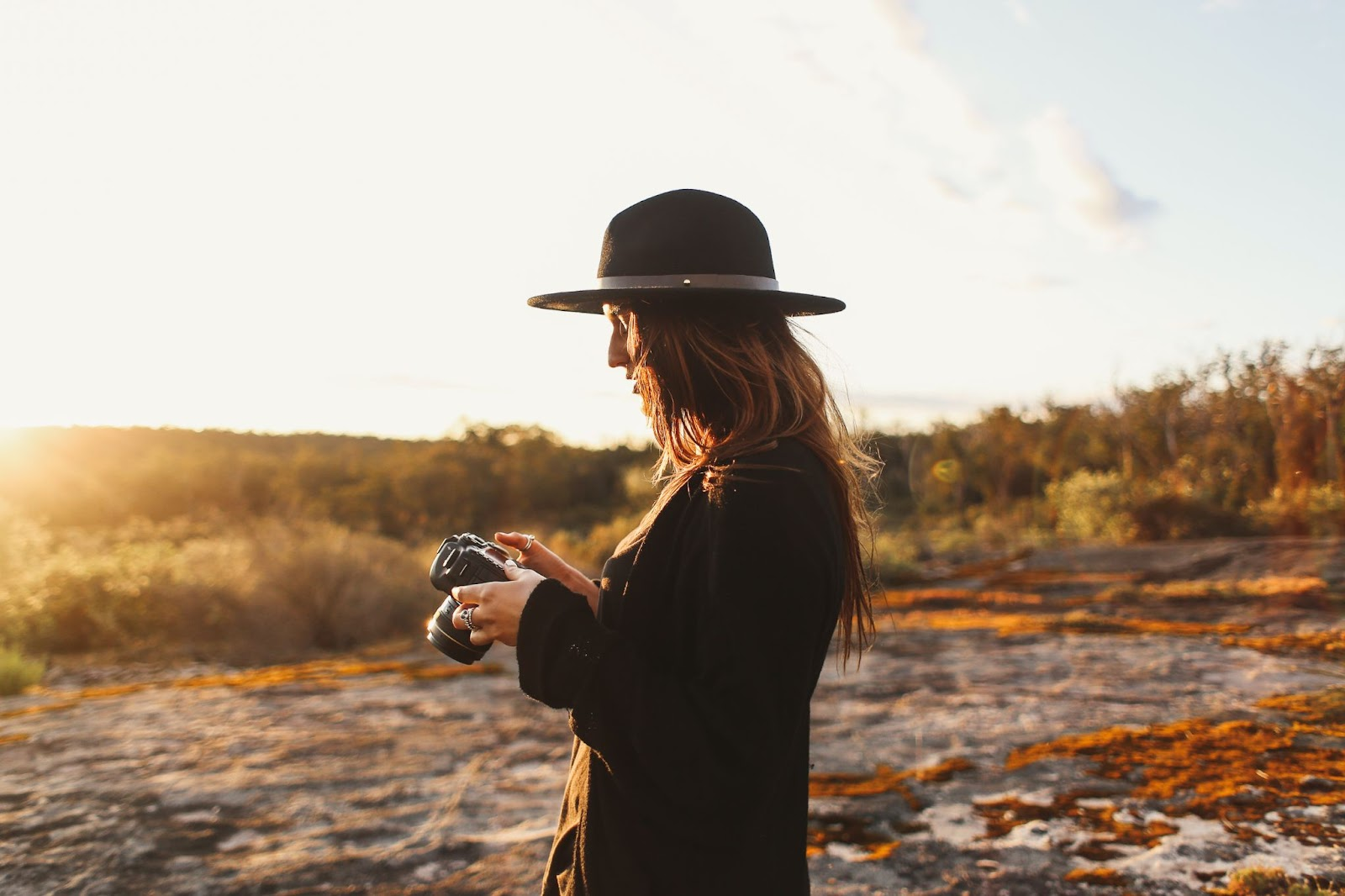 Picture of a lady working with her camera. This is concerning an article on how to insure camera equipment when traveling abroad.