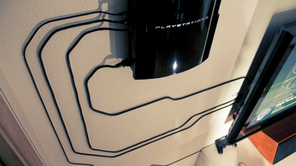 PS3 decoratively mounted on wall