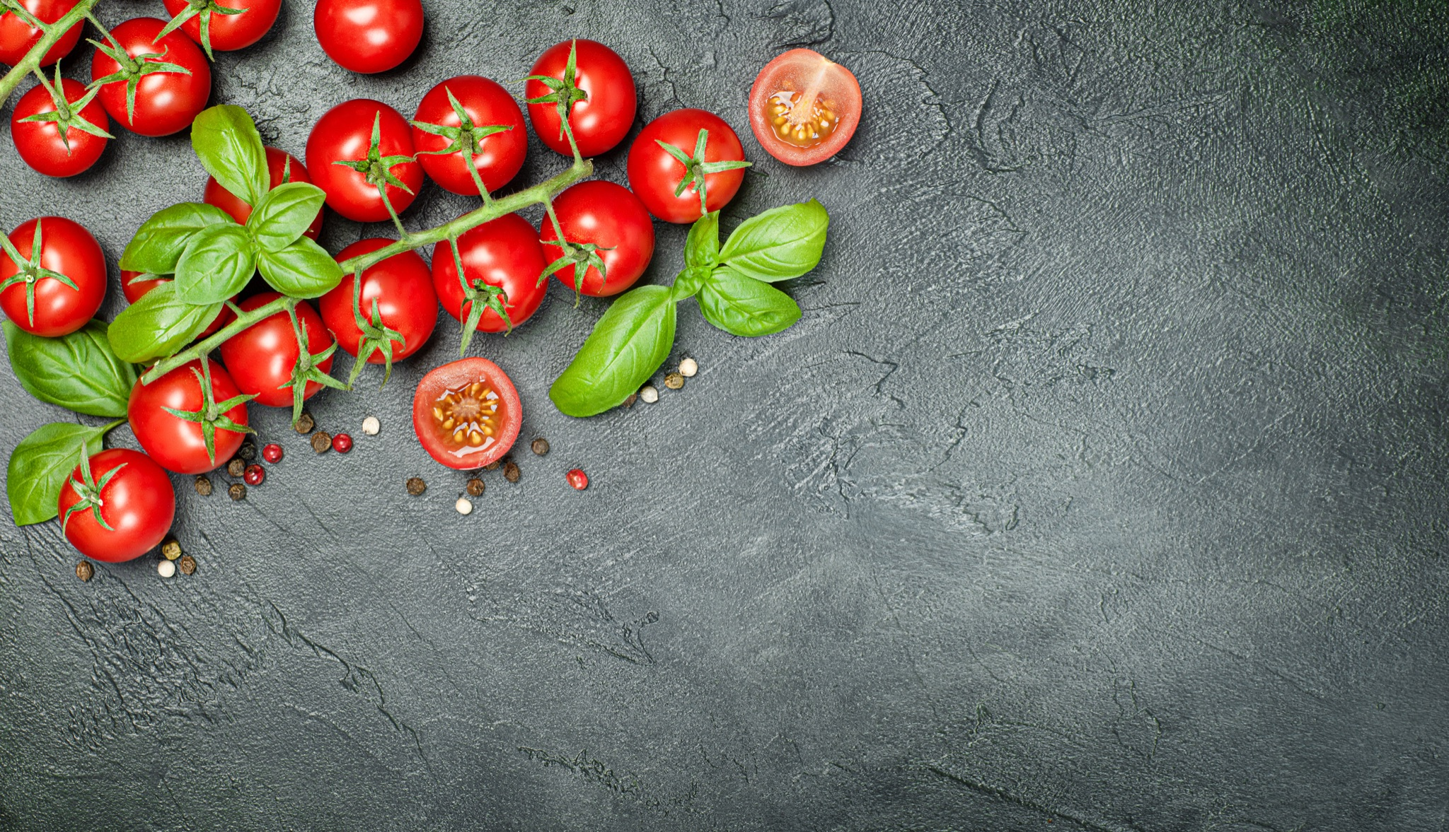 Concrete countertop with cherry tomatoes and basil