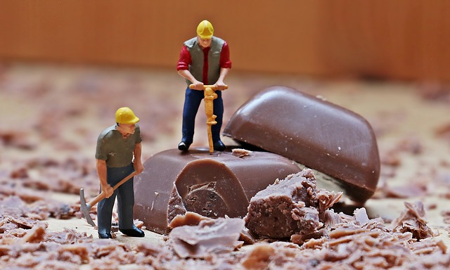 Toy workman breaking up chocolate