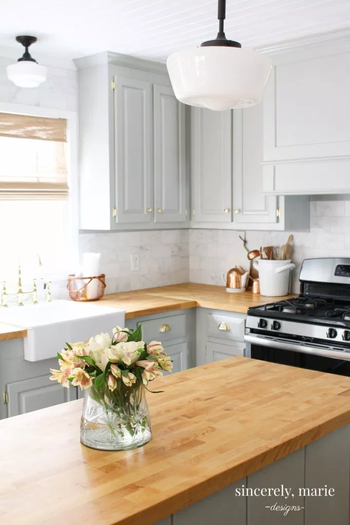 light grey cabinets with butcher block countertops and butcher block island
