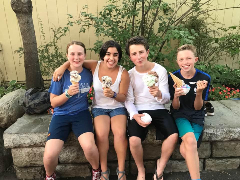 Spanish girl and host siblings eating ice cream