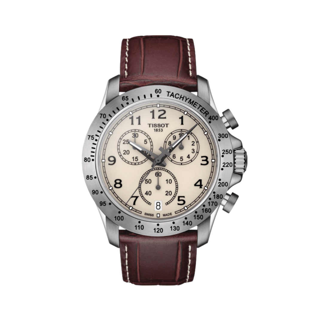 Tissot chronograph with a beige dial and a silver bezel. With a brown leather strap.