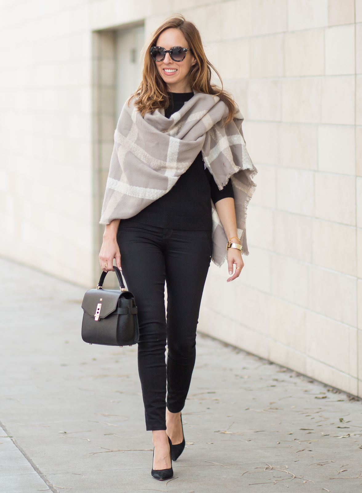 chic blanket scarf thrown over shoulder