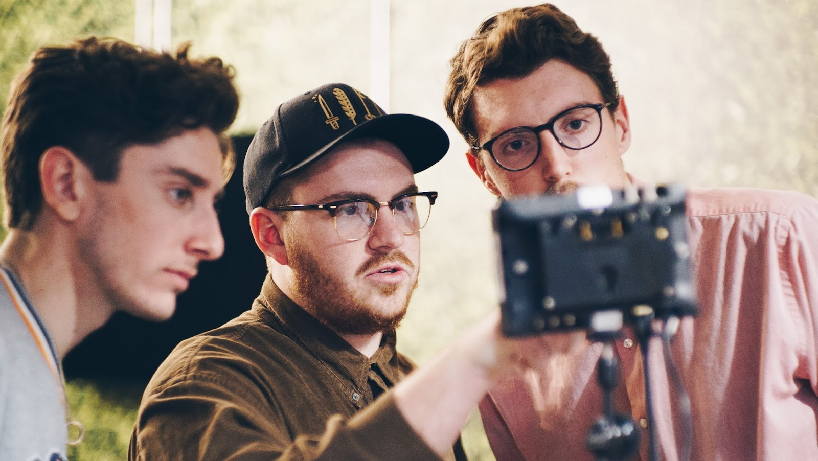Max behind the camera with friends