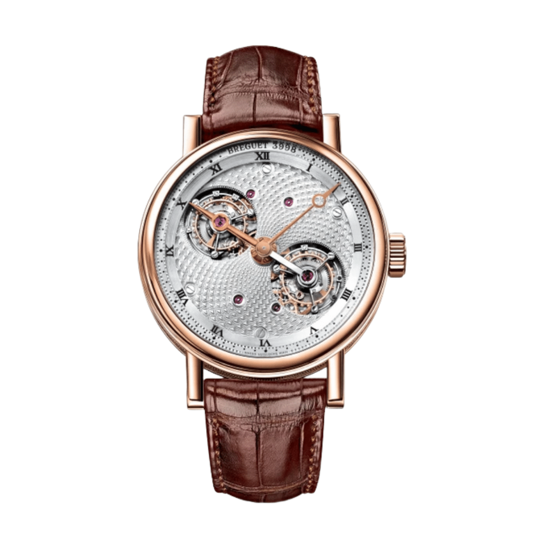 A double tourbillon 5347  from Breugett. With a gold case, and gold Breguet hands. With a decorated silver dial. With two exposed tourbillons.