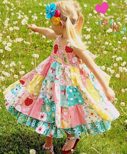 Little Girl Twirling in Patchwork Dress