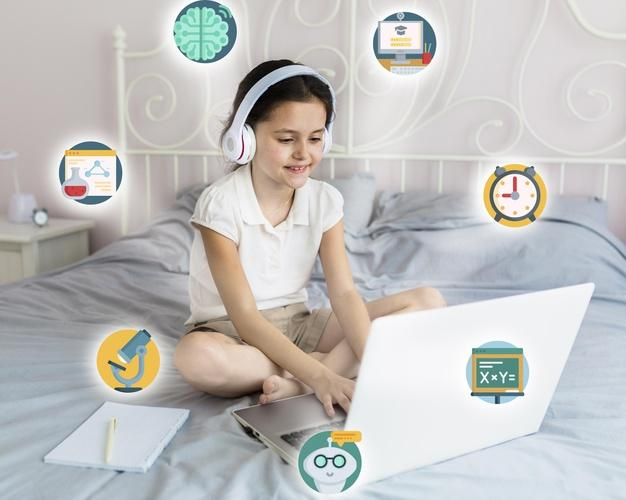Young girl learning on her laptop Free Photo