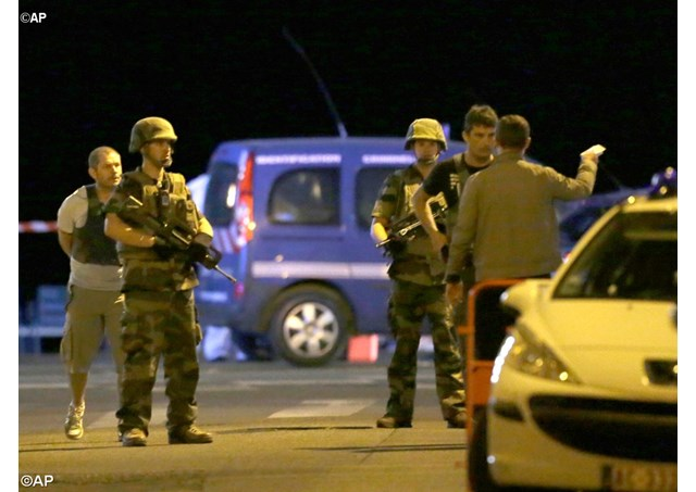 Police officers and soldiers at the scene of a terrorist attack in Nice, France. At least 84 people were killed after a man drove a heavy truck into a crowd of people celebrating Bastille Day. - AP