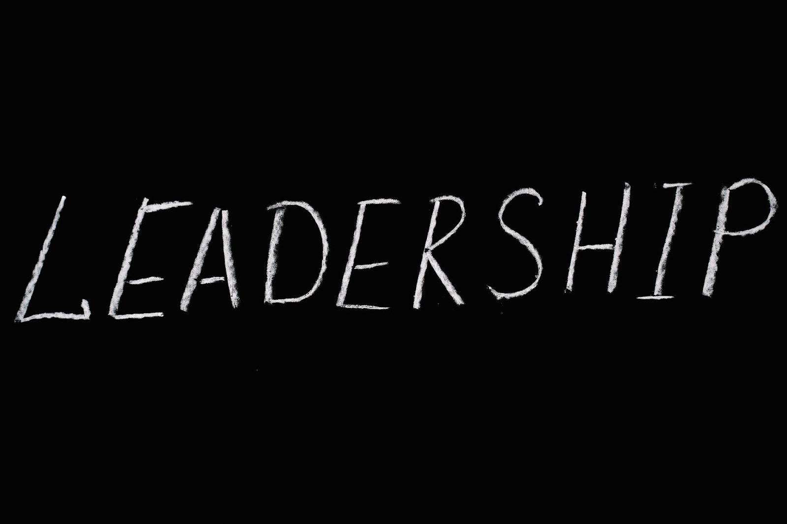 The word leadership over black text