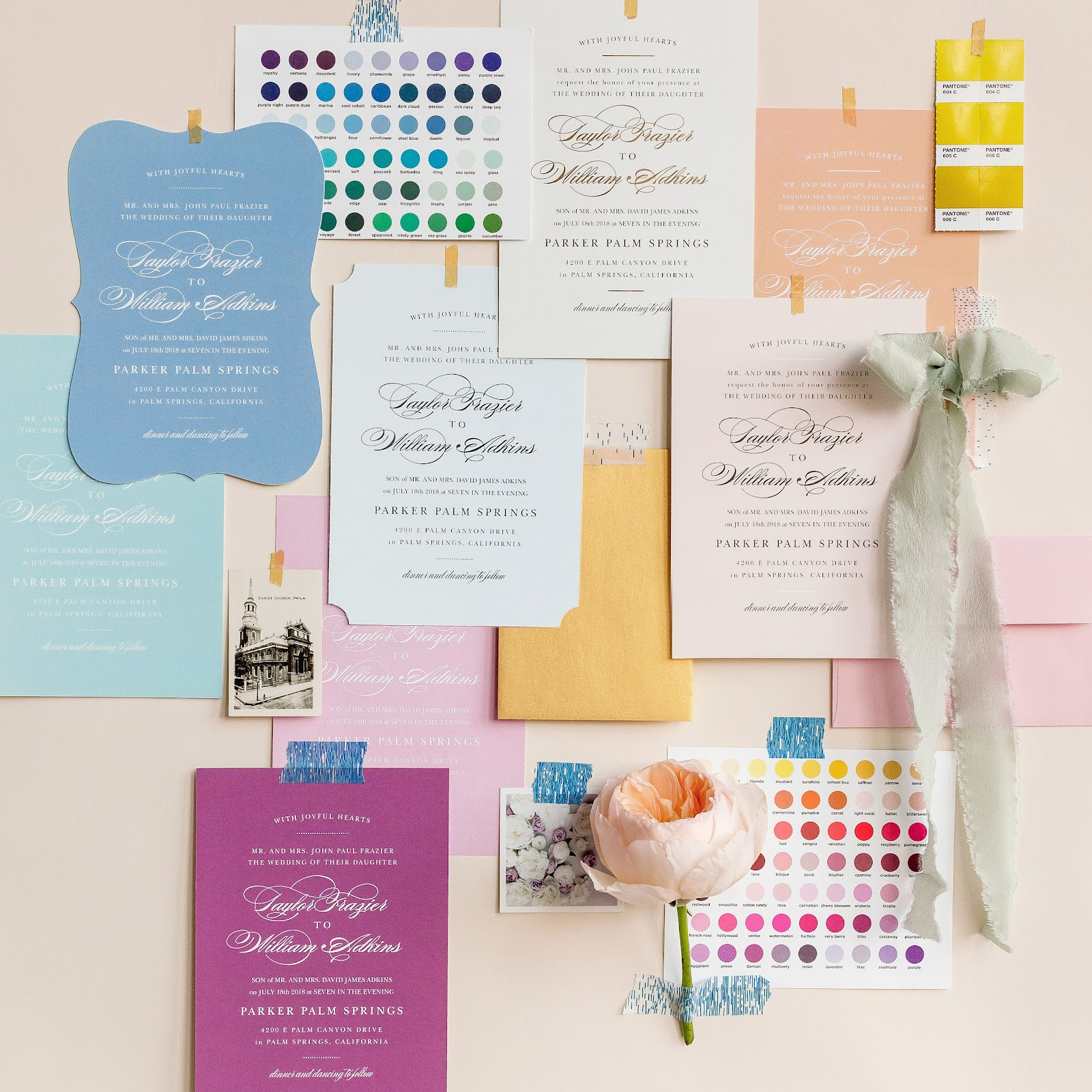 Inspiration board with wedding invitations, color palettes, ribbons and envelopes.