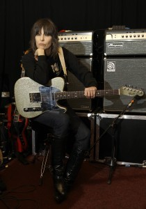 FILE - In a Jan. 22, 2009 file photo, singer Chrissie Hynde, lead singer of the Pretenders, pauses during rehearsals at John Henry's Studio in north London. The biggest clash of fans might just happen the night before the Super Bowl when The Pretenders and Faith Hill perform together live from Grand Prairie, Texas. (AP Photo/Joel Ryan, File)