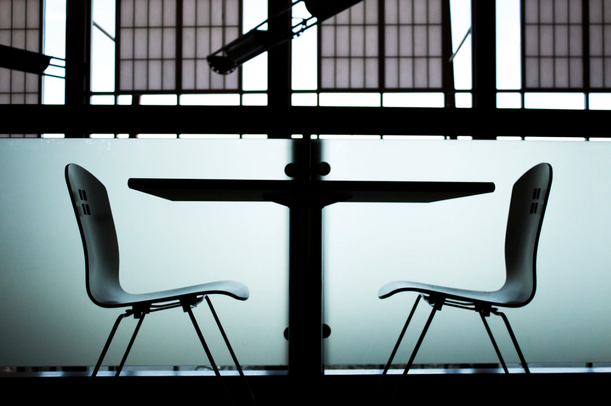 Two chairs at a table in an office space