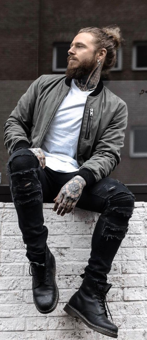 A man wearing a grey leather jacket