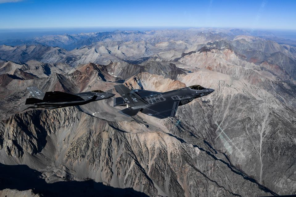 Two U.S. Navy F-35C fly in formation for a photo exercise and the result is simply stunning