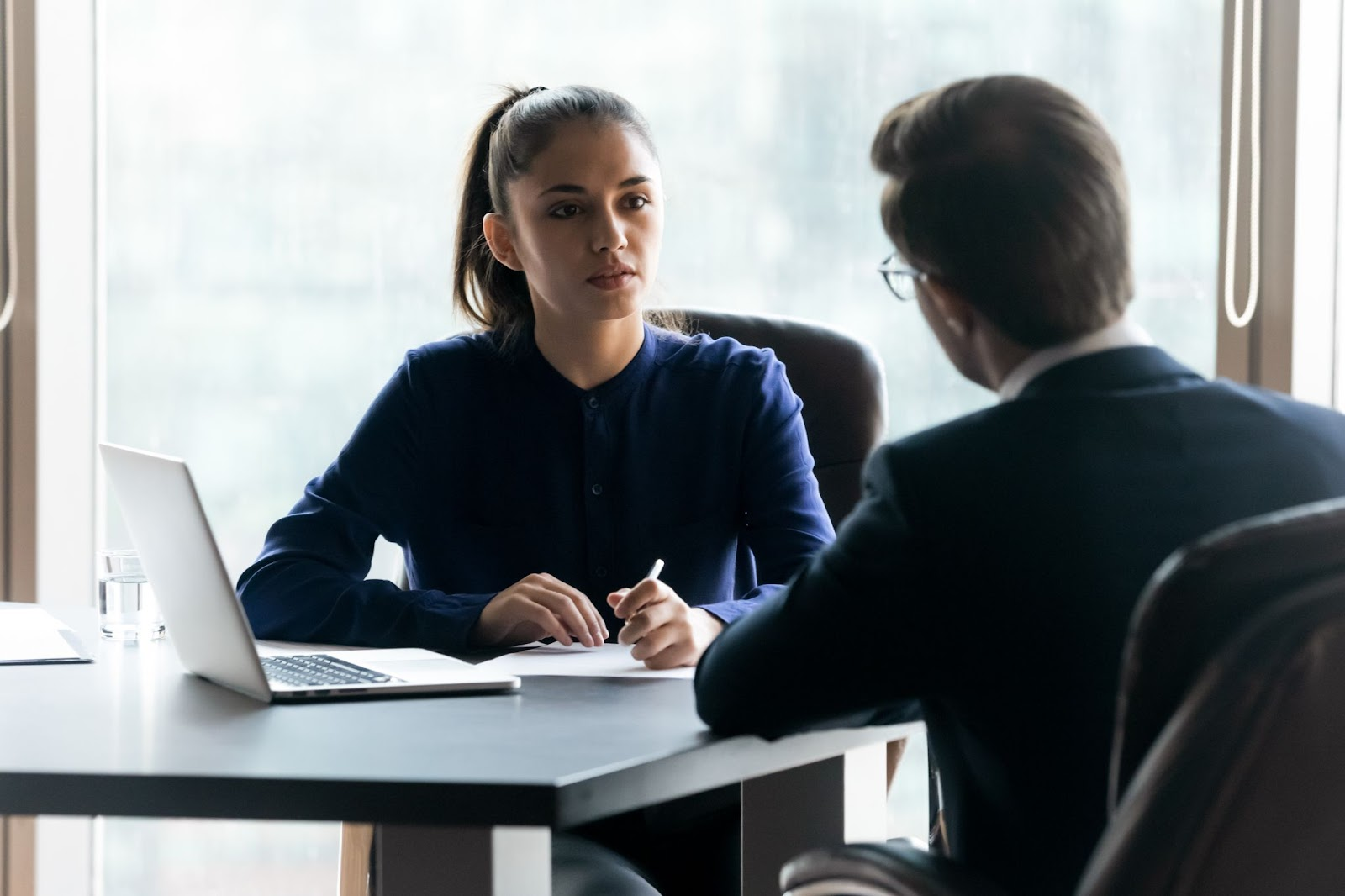 what are qualified dividends: Woman interviewing an applicant