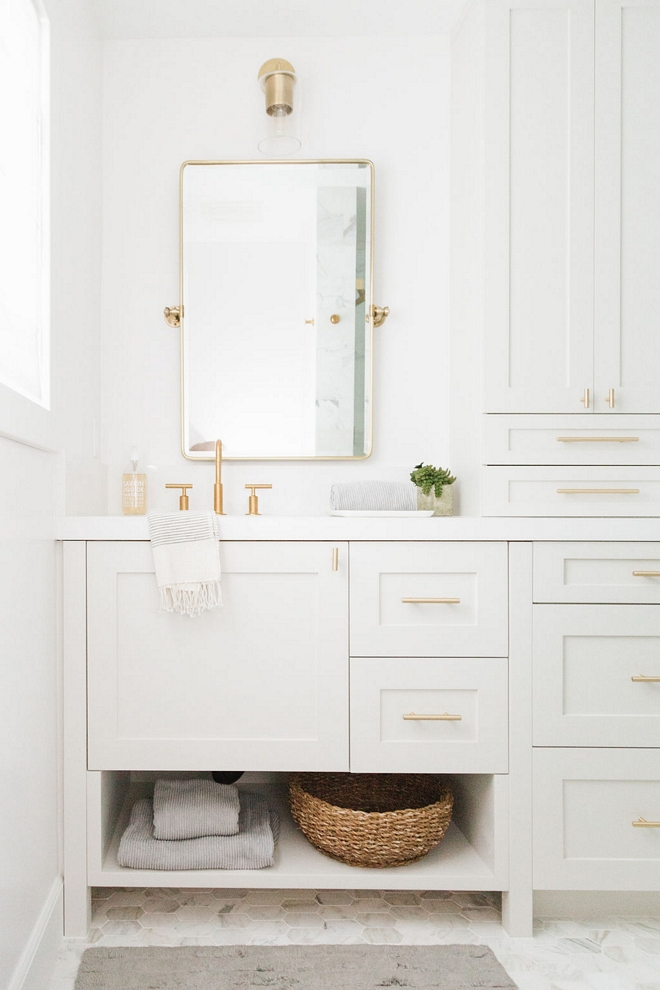 white shaker cabinet bathroom vanity with brass hardware