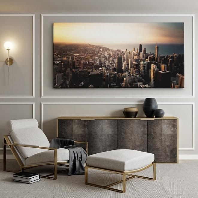 a large canvas print in the empty living room wall